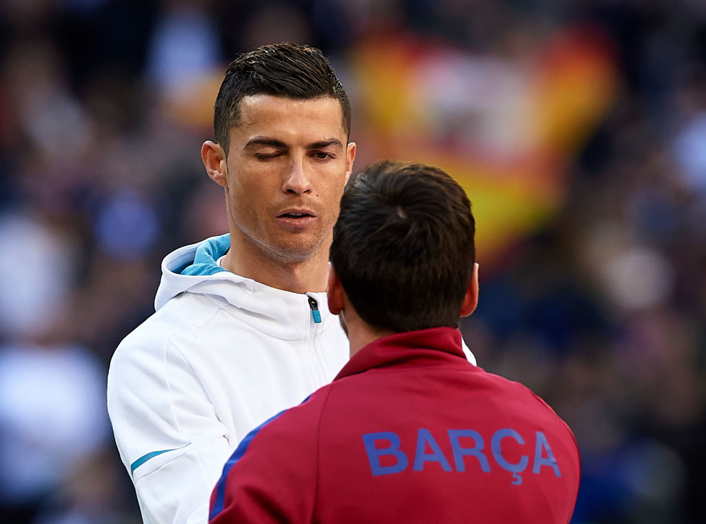 MADRID, SPAIN - DECEMBER 23: Cristiano Ronaldo of Real Madrid greets Lionel Messi of Barcelona prior to the La Liga match between Real Madrid and Barcelona at Estadio Santiago Bernabeu on December 23, 2017 in Madrid, Spain.  (Photo by fotopress/Getty Images)