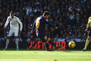 MADRID, SPAIN - DECEMBER 23: Lionel Messi of Barcelona scores his sides second goal from the penalty spot during the La Liga match between Real Madrid and Barcelona at Estadio Santiago Bernabeu on December 23, 2017 in Madrid, Spain.  (Photo by Denis Doyle/Getty Images)