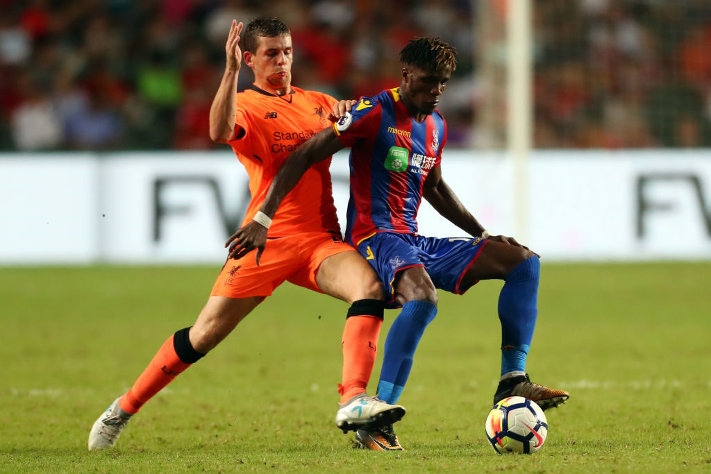HONG KONG - JULY 19:  Wilfried Zaha of Crystal Palace shields the ball away John Flanagan of Liverpool during the Premier League Asia Trophy match between Liverpool and Crystal Palace at Hong Kong Stadium on July 19, 2017 in Hong Kong, Hong Kong.  (Photo by Stanley Chou/Getty Images)