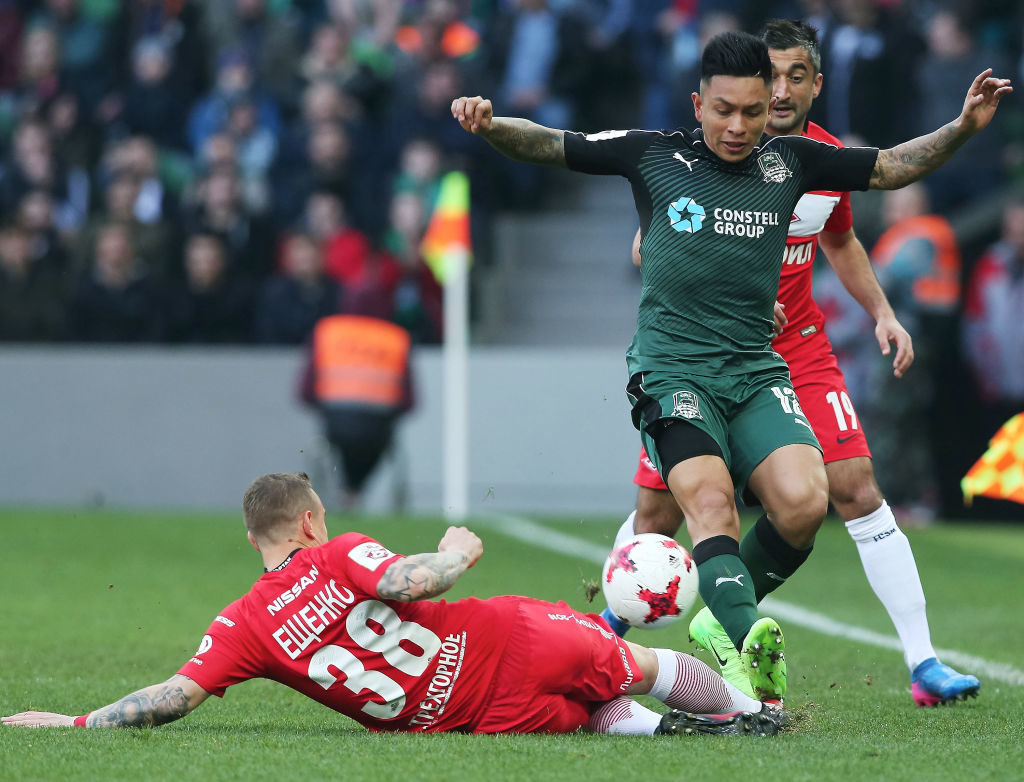 KRASNODAR, RUSSIA - MARCH 05: Cristian Ramirez (R) of FC Krasnodar is challenged by Andrey Yeshchenko of FC Spartak Moscow during the Russian Premier League match between FC Krasnodar v FC Spartak Moscow at Krasnodar Stadium on March 05, 2017 in Krasnodar, Russia. (Photo by Epsilon/Getty Images)
