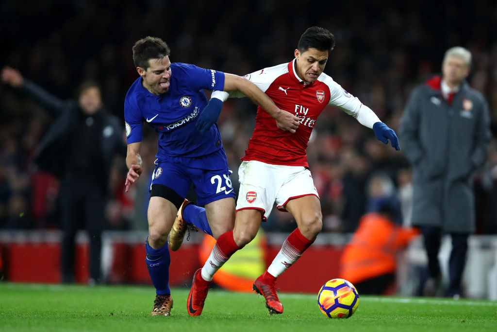 LONDON, ENGLAND - JANUARY 03:  Cesar Azpilicueta of Chelsea and Alexis Sanchez of Arsenal battle for possession during the Premier League match between Arsenal and Chelsea at Emirates Stadium on January 3, 2018 in London, England.  (Photo by Julian Finney/Getty Images)
