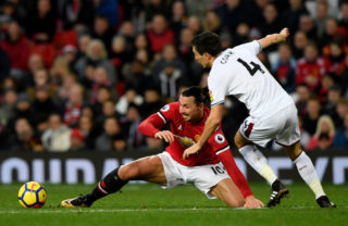 MANCHESTER, ENGLAND - DECEMBER 26:  Zlatan Ibrahimovic of Manchester United is tackled by Jack Cork of Burnley during the Premier League match between Manchester United and Burnley at Old Trafford on December 26, 2017 in Manchester, England.  (Photo by Stu Forster/Getty Images)