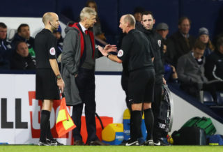 WEST BROMWICH, ENGLAND - DECEMBER 31:  Arsene Wenger, Manager of Arsenal in discussion with referee Mike Dean during the Premier League match between West Bromwich Albion and Arsenal at The Hawthorns on December 31, 2017 in West Bromwich, England.  (Photo by Michael Steele/Getty Images)