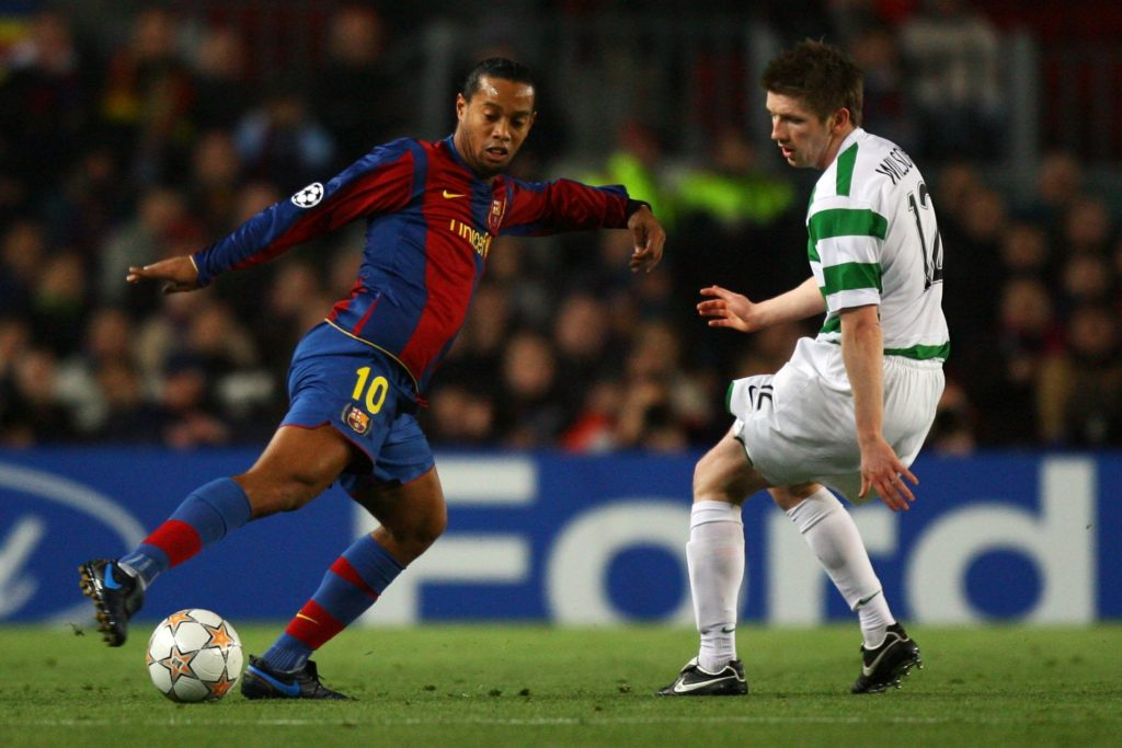 BARCELONA, SPAIN - MARCH 04:  Ronaldinho of Barcelona gets past Mark Wilson of Celtic during the UEFA Champions League 2nd leg of the First knockout round match between FC Barcelona and Celtic at the Camp Nou stadium on March 4, 2007 in Barcelona, Spain.  (Photo by Ryan Pierse/Getty Images)