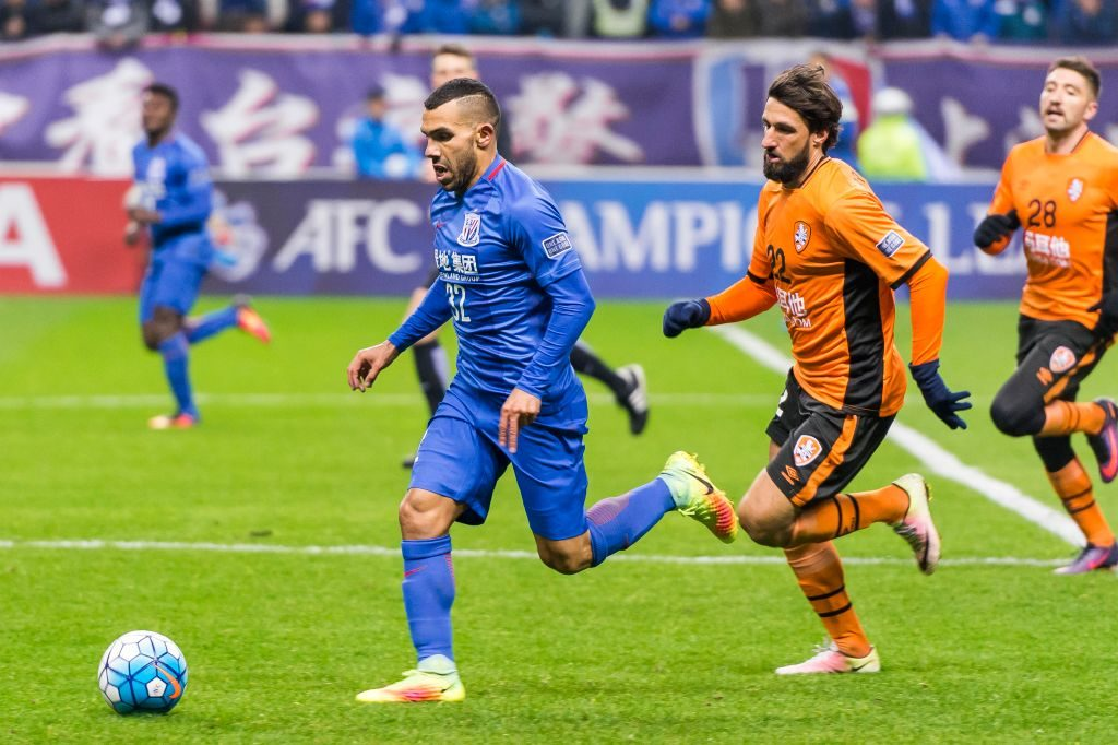 SHANGHAI, CHINA - FEBRUARY 08: Carlos Tevez of Shanghai Shenhua FC in action during their AFC Champions League 2017 Playoff Stage match between Shanghai Shenhua FC (CHN) and Brisbane Roar (AUS) at the Hongkou Stadium, on 08 February 2017 in Shanghai, China. (Photo by Power Sport Images/Getty Images)