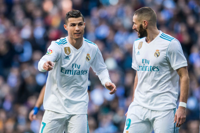 MADRID, SPAIN - DECEMBER 23: Cristiano Ronaldo (L) of Real Madrid talks to teammate Karim Benzema during the La Liga 2017-18 match between Real Madrid and FC Barcelona at Santiago Bernabeu Stadium on December 23 2017 in Madrid, Spain. (Photo by Power Sport Images/Getty Images)