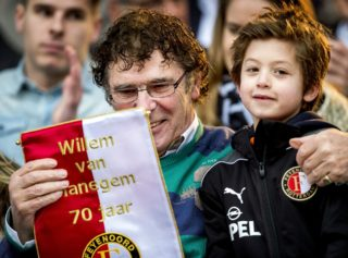 Dutch former soccer player and Feyenoord icon Willem van Hanegem receives a present from a young player during the celebration of his 70th birthday in the Kuip, the Feyenoord stadium in Rotterdam, on February 20, 2014. A stand in the stadium is named after Van Hanegem. AFP PHOTO/ANP KOEN VAN WEEL  netherlands out  / AFP PHOTO / ANP / Koen van Weel