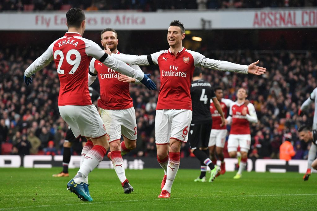 Arsenal's French defender Laurent Koscielny (R) celebrates after scoring their third goal with Arsenal's Swiss midfielder Granit Xhaka during the English Premier League football match between Arsenal and Crystal Palace at the Emirates Stadium in London on January 20, 2018.  / AFP PHOTO / Ben STANSALL / RESTRICTED TO EDITORIAL USE. No use with unauthorized audio, video, data, fixture lists, club/league logos or 'live' services. Online in-match use limited to 75 images, no video emulation. No use in betting, games or single club/league/player publications.  /