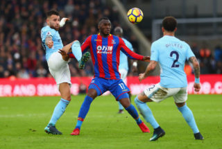 LONDON, ENGLAND - DECEMBER 31:  Christian Benteke of Crystal Palace is marshalled by Nicolas Otamendi and Kyle Walker of Manchester City during the Premier League match between Crystal Palace and Manchester City at Selhurst Park on December 31, 2017 in London, England.  (Photo by Clive Rose/Getty Images)