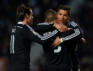 ELCHE, SPAIN - FEBRUARY 22:  Karim Benzema of Real Madrid celebrates after scoring with his teammates Cristiano Ronaldo (R) and Gareth Bale during the La Liga match between Elche FC and Real Madrid at Estadio Manuel Martinez Valero on February 22, 2015 in Elche, Spain.  (Photo by Manuel Queimadelos Alonso/Getty Images)