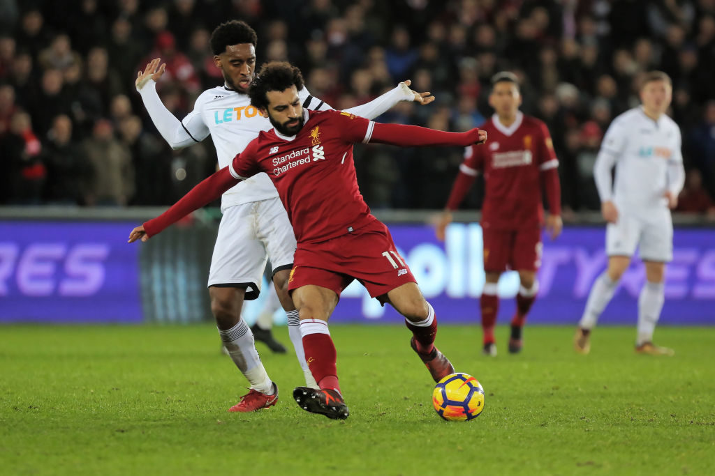 SWANSEA, WALES - JANUARY 22: (L-R) Leroy Fer of Swansea City challenges  Mohamed Salah of Liverpool during the Premier League match between Swansea City and Liverpool at The Liberty Stadium on January 22, 2018 in Swansea, Wales. (Photo by Athena Pictures/Getty Images)