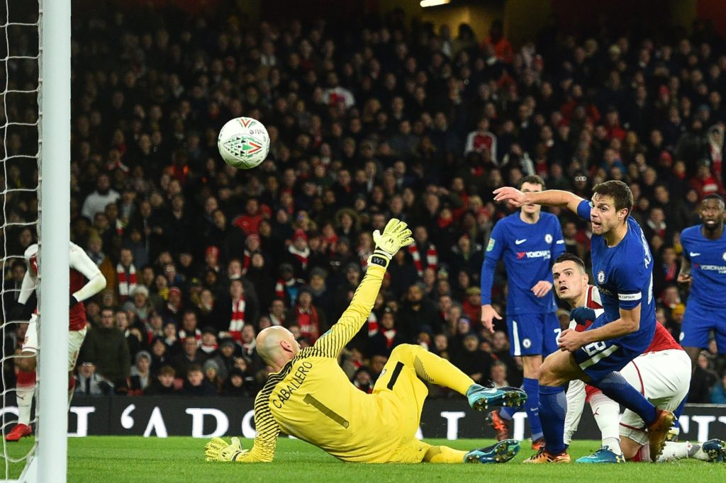 Arsenal's Swiss midfielder Granit Xhaka (2R) scores the team's second goal during the League Cup semi-final football match between Arsenal and Chelsea at the Emirates Stadium in London on January 24, 2018.  / AFP PHOTO / Glyn KIRK / RESTRICTED TO EDITORIAL USE. No use with unauthorized audio, video, data, fixture lists, club/league logos or 'live' services. Online in-match use limited to 75 images, no video emulation. No use in betting, games or single club/league/player publications.  /