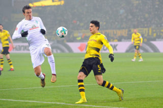 DORTMUND, GERMANY - DECEMBER 09: Max Kruse of Bremen and Marc Bartra Aregall of Dortmund battle for the ball during the Bundesliga match between Borussia Dortmund and SV Werder Bremen at Signal Iduna Park on December 9, 2017 in Dortmund, Germany. (Photo by TF-Images/TF-Images via Getty Images)
