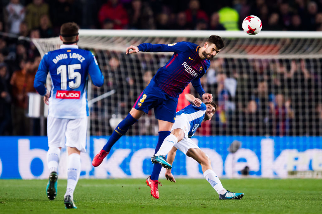 BARCELONA, SPAIN - JANUARY 25: Gerard Pique of FC Barcelona wins the header over Leo Baptistao of RCD Espanyol during the Spanish Copa del Rey Quarter Final Second Leg match between FC Barcelona and RCD Espanyol at Camp Nou stadium at Camp Nou on January 25, 2018 in Barcelona, Spain. (Photo by Alex Caparros/Getty Images)