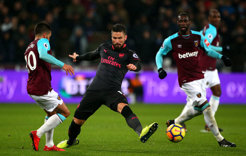 LONDON, ENGLAND - DECEMBER 13: Manuel Lanzini of West Ham United is put under pressure by Olivier Giroud of Arsenal during the Premier League match between West Ham United and Arsenal at London Stadium on December 13, 2017 in London, England.  (Photo by Charlie Crowhurst/Getty Images)