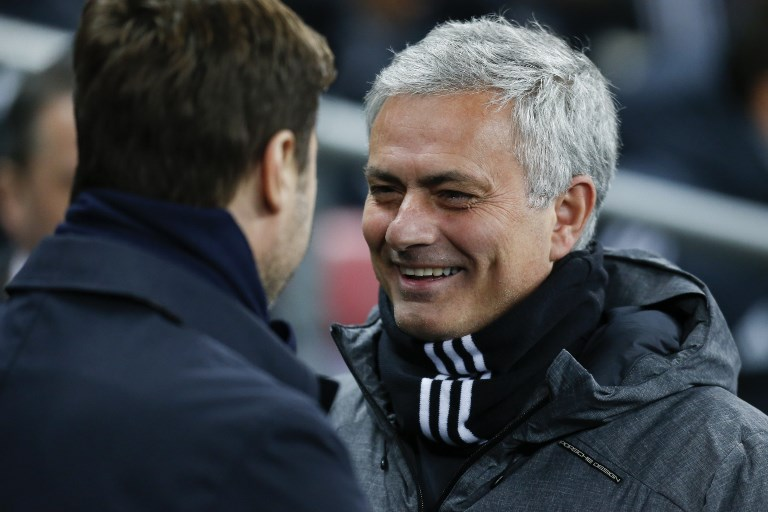 Manchester United's Portuguese manager Jose Mourinho (R) greets Tottenham Hotspur's Argentinian head coach Mauricio Pochettino (L) for the English Premier League football match between Tottenham Hotspur and Manchester United at Wembley Stadium in London, on January 31, 2018. / AFP PHOTO / IKIMAGES / Ian KINGTON / RESTRICTED TO EDITORIAL USE. No use with unauthorized audio, video, data, fixture lists, club/league logos or 'live' services. Online in-match use limited to 45 images, no video emulation. No use in betting, games or single club/league/player publications.  /