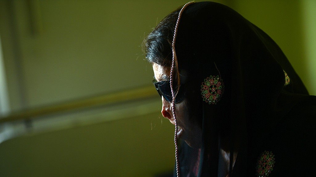 To go with story 'Pakistan-social-woman-crime-acid,FEATURE' by Jennie MatthewIn this photo taken on February 12, 2013, Naziran Bibi, an acid attack victim waits for eye surgery at a hospital in Rawalpindi. Few have much faith in the Pakistani courts, but campaigners say the conviction rate for acid attacks has tripled since tough new penalties were signed into law in late 2011.  AFP PHOTO/Farooq NAEEM