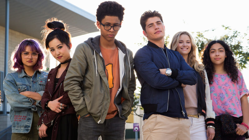 """MARVEL'S RUNAWAYS - """"Reunion"""" - Episode 101 - Every teenager thinks their parents are evil. What if you found out they actually were?  MarvelÕs Runaways is the story of six diverse teenagers who can barely stand each other but who must unite against a common foe Ð their parents. The 10-episode series premieres Tuesday, November 21st. The series stars Rhenzy Feliz, Lyrica Okano, Virginia Gardner, Ariela Barer, Gregg Sulkin, Allegra Acosta, Annie Wersching, Ryan Sands, Angel Parker, Ever Carradine, James Marsters, Kevin Weisman, Brigid Brannah, James Yaegashi, Brittany Ishibashi, and Kip Pardue. From left: Gert Yorkes (Ariela Barer), Nico Minoru (Lyrica Okano), Alex Wilder (Rhenzy Feliz), Chase Stein (Gregg Sulkin), Karolina Dean (Virginia Gardner) and Molly Hernandez (Allegra Acosta), shown. (Photo by: Paul Sarkis/Hulu)"""